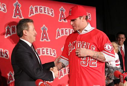 Angels owner Arte Moreno was all smiles when he signed Hamilton in December 2012. (Getty Images)