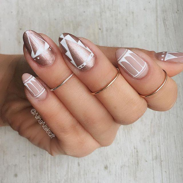 """<p>You're going to need a steady hand for this intricate aztec effect, or just a really good nail technician.</p><p><a href=""""https://www.instagram.com/p/BOnQiyRB2MH/"""" rel=""""nofollow noopener"""" target=""""_blank"""" data-ylk=""""slk:See the original post on Instagram"""" class=""""link rapid-noclick-resp"""">See the original post on Instagram</a></p>"""