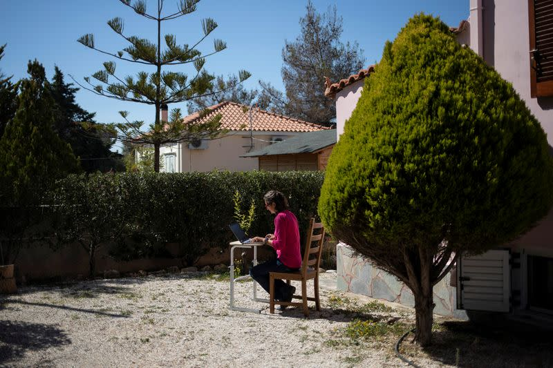 Rowena Harding works at the garden of her house, on the island of Aegina
