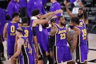 Los Angeles Lakers' LeBron James (23) talks with Dwight Howard (39) during a timeout in the second half of an NBA conference final playoff basketball game against the Denver Nuggets Saturday, Sept. 26, 2020, in Lake Buena Vista, Fla. The Lakers won 117-107 to win the series 4-1.(AP Photo/Mark J. Terrill)