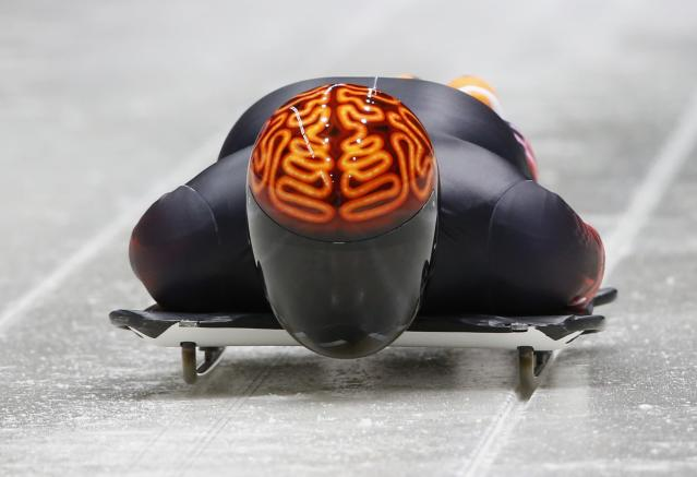 Canada's John Fairbairn speeds down during an unofficial men's skeleton progressive training at the Sanki sliding center in Rosa Khutor, a venue for the Sochi 2014 Winter Olympics near Sochi, February 5, 2014. REUTERS/Murad Sezer (RUSSIA - Tags: SPORT OLYMPICS SKELETON)