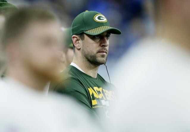 Green Bay Packers quarterback Aaron Rodgers watches from the sideline during the second half of an NFL football game against the Detroit Lions, Sunday, Dec. 31, 2017, in Detroit. (AP Photo/Duane Burleson)