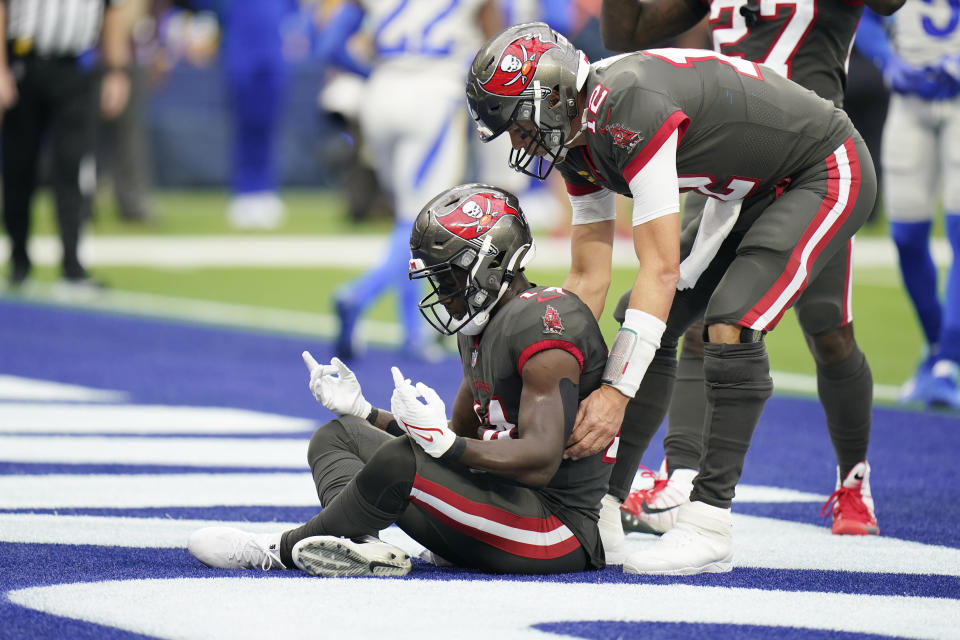 Tampa Bay Buccaneers wide receiver Chris Godwin, left, celebrates with quarterback Tom Brady after Godwin scored a touchdown during the first half of an NFL football game Sunday, Sept. 26, 2021, in Inglewood, Calif. (AP Photo/Jae C. Hong)