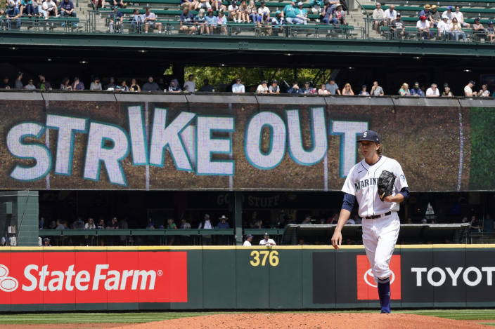 Seattle Mariners starting pitcher Logan Gilbert waits for the next batter after striking out New York Yankees' Gio Urshela in the second inning of a baseball game Thursday, July 8, 2021, in Seattle. (AP Photo/Elaine Thompson)
