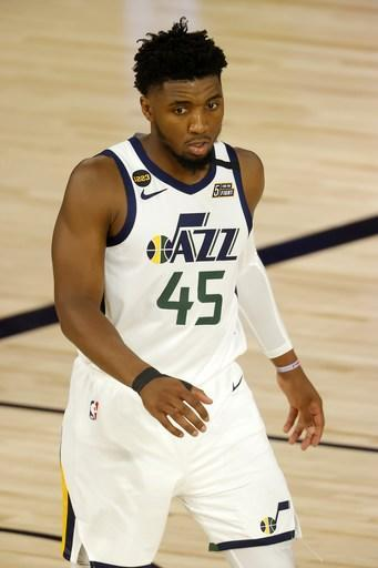 Utah Jazz's Donovan Mitchell stands on the court during the fourth quarter against the Denver Nuggets in Game 5 of an NBA basketball first-round playoff series, Tuesday, Aug. 25, 2020, in Lake Buena Vista, Fla. (Mike Ehrmann/Pool Photo via AP)