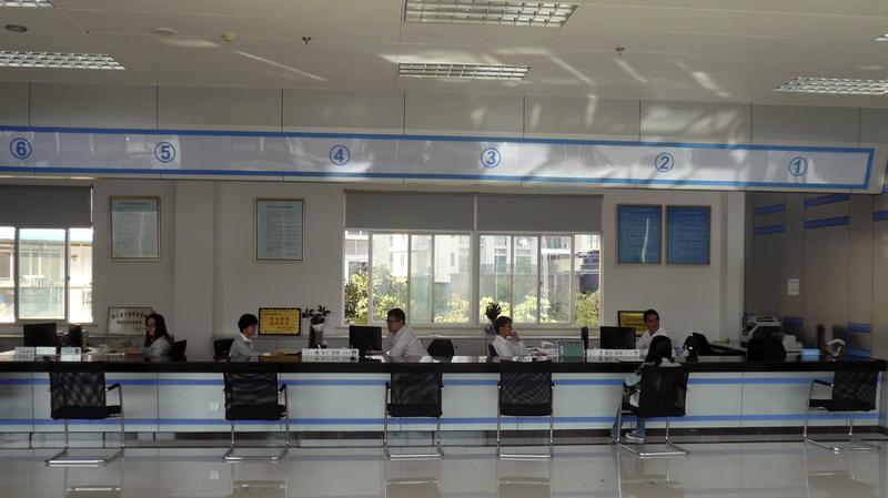 Clerks wait for customers inside Wenzhou Private Lending Service Center, in Wenzhou
