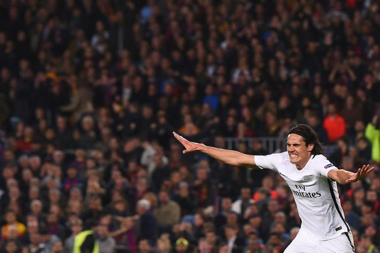 Paris Saint-Germain's forward Edinson Cavani celebrates after scoring their first goal during the UEFA Champions League round of 16 second leg football match FC Barcelona vs Paris Saint-Germain FC at the Camp Nou stadium in Barcelona on March 8, 2017