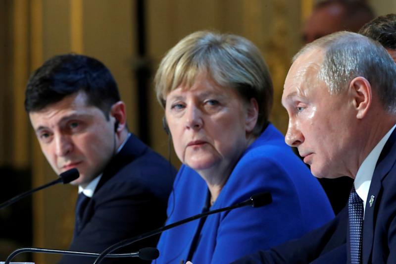 Ukraine's President Volodymyr Zelenskiy, German Chancellor Angela Merkel and Russia's President Vladimir Putin attend a joint news conference after a Normandy-format summit in Paris, France December 10, 2019. REUTERS/Charles Platiau/Pool? TPX IMAGES OF THE DAY