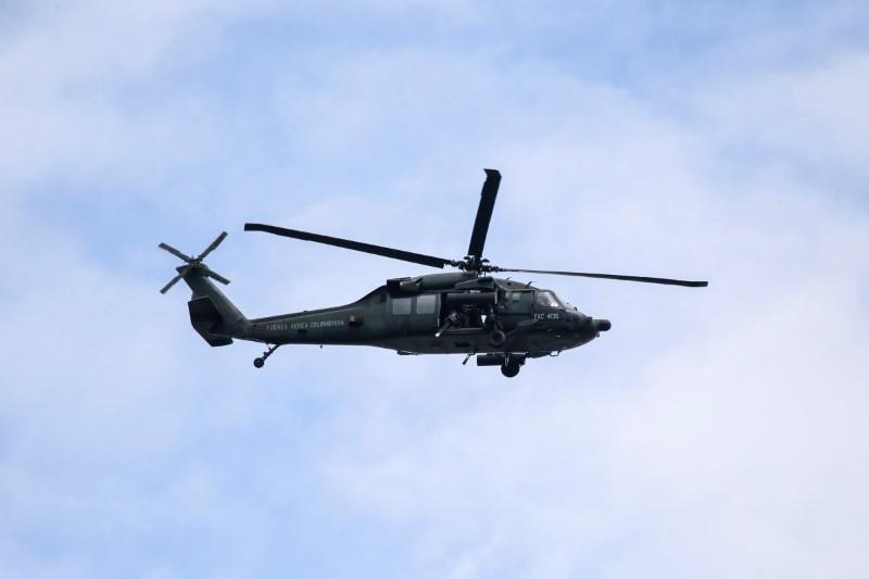 A military helicopter flies over a military battalion where a car bomb exploded, according to authorities, in Cucuta