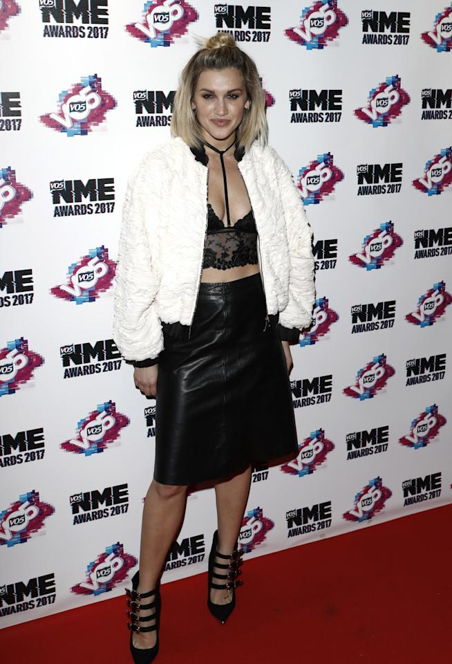 <p>That white jacket softens the leather skirt and bralet nicely [Photo: Getty/John Phillips] </p>
