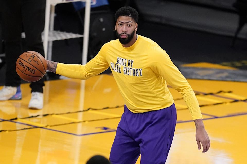 Los Angeles Lakers forward Anthony Davis warms up before an NBA basketball game against the Denver Nuggets Thursday, Feb. 4, 2021, in Los Angeles. (AP Photo/Marcio Jose Sanchez)