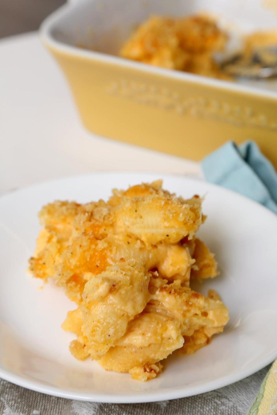 """<p>If incredibly rich macaroni and cheese with a crunchy breadcrumb topping is your kind of mac and cheese, this is the only recipe you'll need for the rest of your life. Chrissy's garlicky breadcrumbs take this shells mac to the next level, and you'll want to put them on everything.</p> <p><strong>Get the recipe:</strong> <a href=""""https://www.popsugar.com/food/John-Legend-Chrissy-Teigen-Mac-Cheese-Recipes-41077588"""" class=""""link rapid-noclick-resp"""" rel=""""nofollow noopener"""" target=""""_blank"""" data-ylk=""""slk:Chrissy Teigen's mac and cheese"""">Chrissy Teigen's mac and cheese</a></p>"""