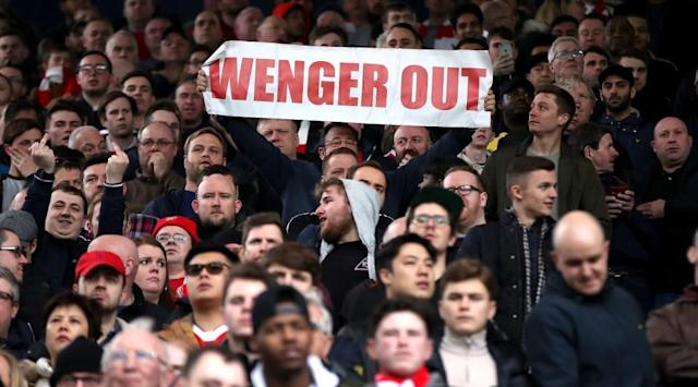 <p>A fan holds up a banner, during the English Premier League soccer match between West Bromwich Albion and Arsenal </p>