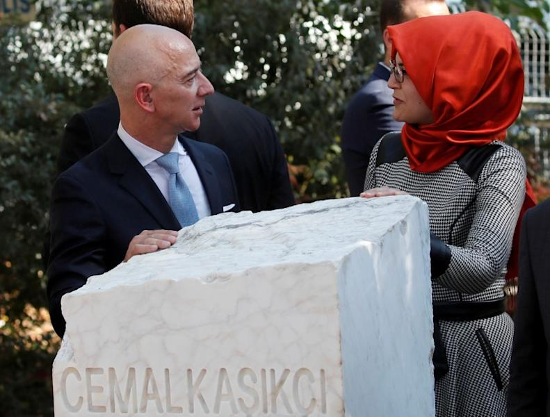 FILE PHOTO: Hatice Cengiz, fiancee of the murdered Saudi journalist Jamal Khashoggi, and Jeff Bezos, founder of Amazon and Blue Origin, talk as they attend a ceremony marking the first anniversary of Khashoggi's killing at the Saudi Consulate, in Istanbul