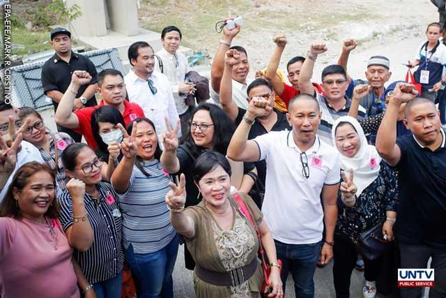 Former Maguindanao Governor and current Congressman Esmael Mangudadatu (3-R) together with relatives of victims gesture to the media after the promulgation of the Maguindanao massacre at Camp Bagong Diwa in Taguig City, Philippines, 19 December 2019. EPA-EFE/MARK CRISTINO