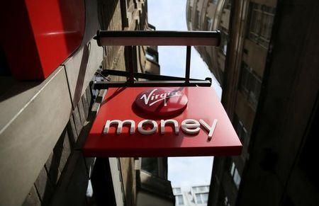 FILE PHOTO: A sign is displayed on a Virgin Money store in London