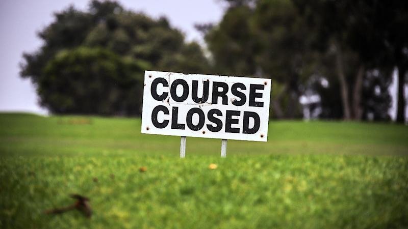 A sign, pictured here displaying the closure of the local Mollymook Golf Course.