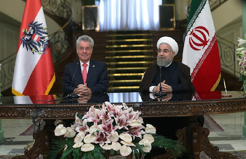 Iranian President Hassan Rouhani (right) holds talks with his Austrian counterpart Heinz Fischer during a press conference in Tehran, on September 8, 2015
