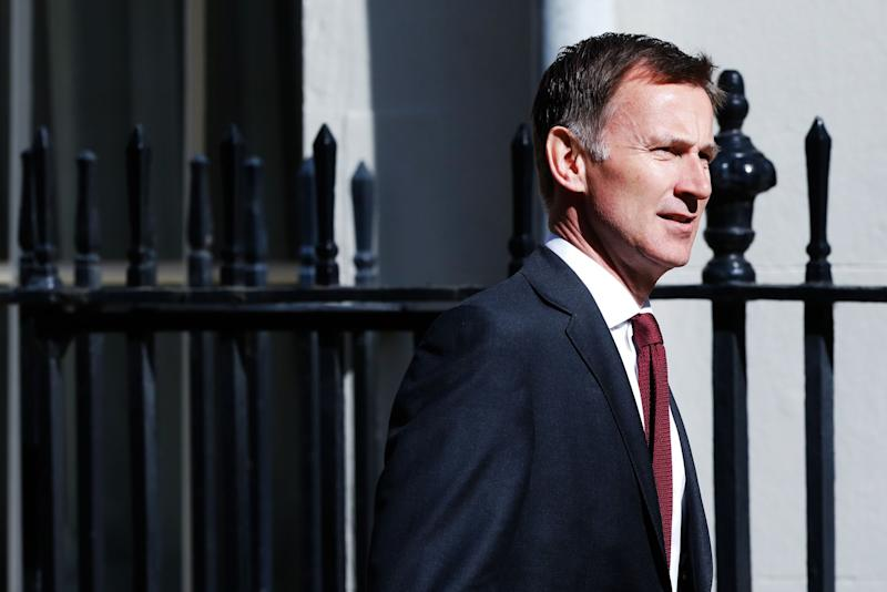 """(Bloomberg) -- Five candidates to become Britain's next prime minister clashed over Brexit in the first TV debate of the Conservative leadership election on Sunday. But the face of Brexit and clear front-runner in the race, Boris Johnson, was criticized after he refused to take part in the Channel 4 broadcast. The contest continues with the second round of voting on Tuesday.Must read: His Critics Say He Lies, But Tories Want to Trust Boris JohnsonKey DevelopmentsDominic Raab sparred with rivals over his threat to suspend Parliament in order to get Britain out of the EU with no dealRaab, Rory Stewart, Michael Gove, Jeremy Hunt and Sajid Javid took part in the first television debate on Channel 4 Cabinet minister Amber Rudd warned Parliament will find a way to stop a no-deal Brexit, and rebel Tories could vote to topple the next PM YouGov/Sunday Times Poll put Nigel Farage's Brexit Party in lead on 24%, with Conservatives and Labour tied on 21%. Liberal Democrats were on 19%. Stewart Wins Applause, Offers to Engage Farage (7:15 p.m.)TV audiences are notoriously unreliable as indicators of broader political appeal, but Rory Stewart won more applause than other candidates in the debate. He has run a convention-defying campaign based on social media and a national tour with the hashtag RoryWalks.But he has his work cut out. Stewart is currently in last place in the MPs' ballot and needs a major injection of support to avoid being knocked out of the race on Tuesday.In the debate, Stewart said he would be willing to work with Nigel Farage on delivering Brexit. Broadening the Tory party's support is something to be """"proud"""" of, he said. """"I'm not ashamed of the fact that Lib Dem and Labour voters say that they would vote for me.""""Stewart insisted the """"energy"""" in Britain is in the political center-ground and that compromise is vital. """"I think we need to work to listen to each other and above all to bring this country together,"""" he said. It was a popular message with the Channel"""