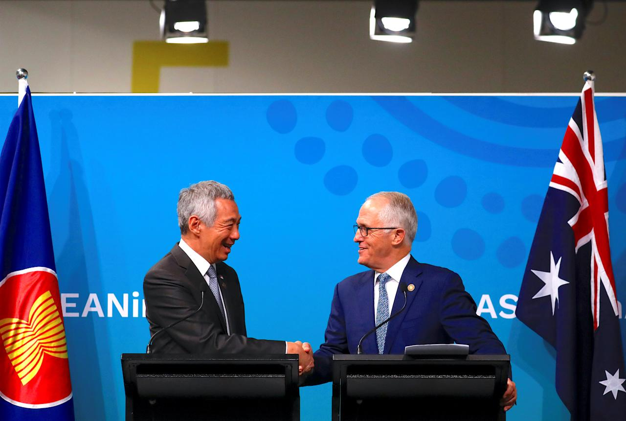 Australian Prime Minister Malcolm Turnbull shakes hands with Prime Minister of Singapore Lee Hsien Loong during their media conference during the one-off summit of 10-member Association of Southeast Asian Nations (ASEAN) in Sydney, Australia, March 18, 2018.     REUTERS/David Gray