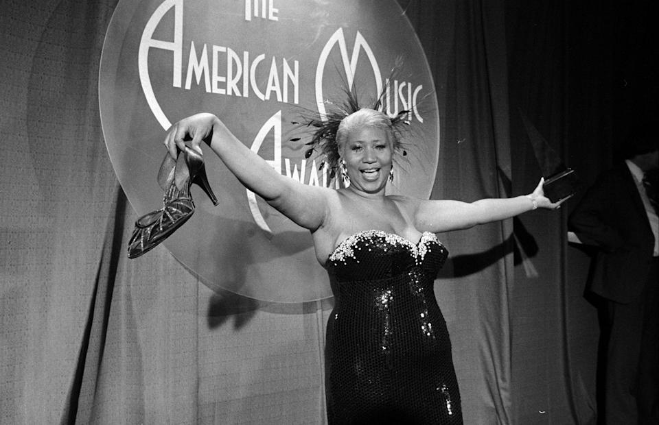 <p>Aretha Franklin wears a strapless black sequin gown with crystals along the bust at the American Music Awards. (Photo by The LIFE Picture Collection/Getty Images) </p>
