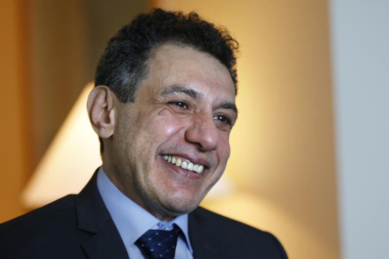 "Nizar Zakka a Lebanese citizen and permanent U.S. resident who was released in Tehran after nearly four years in jail on charges of spying, smiles during an interview with The Associated Press at a hotel in Dbayeh, north of Beirut, Lebanon, Wednesday, June 12, 2019. Zakka, an information technology expert, who was detained in Iran in September 2015 while trying to fly out of Tehran called on President Donald Trump to ""get back your hostages"" from Iran. He was sentenced to 10 years in prison after authorities accused him of being an American spy - allegations vigorously rejected by Zakka, his family and associates. (AP Photo/Bilal Hussein)"