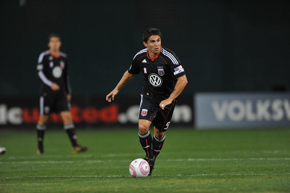D.C. United star Jaime Moreno dribbles the ball on the field during a game.