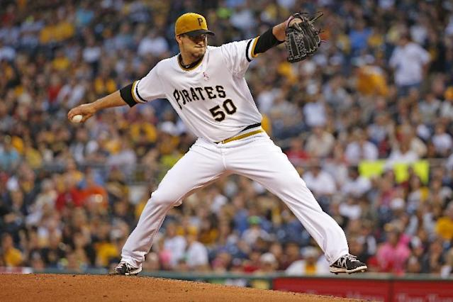 Pittsburgh Pirates starting pitcher Charlie Morton (50) delivers during the first inning of a baseball game against the St. Louis Cardinals in Pittsburgh Sunday, May 11, 2014. (AP Photo/Gene Puskar)
