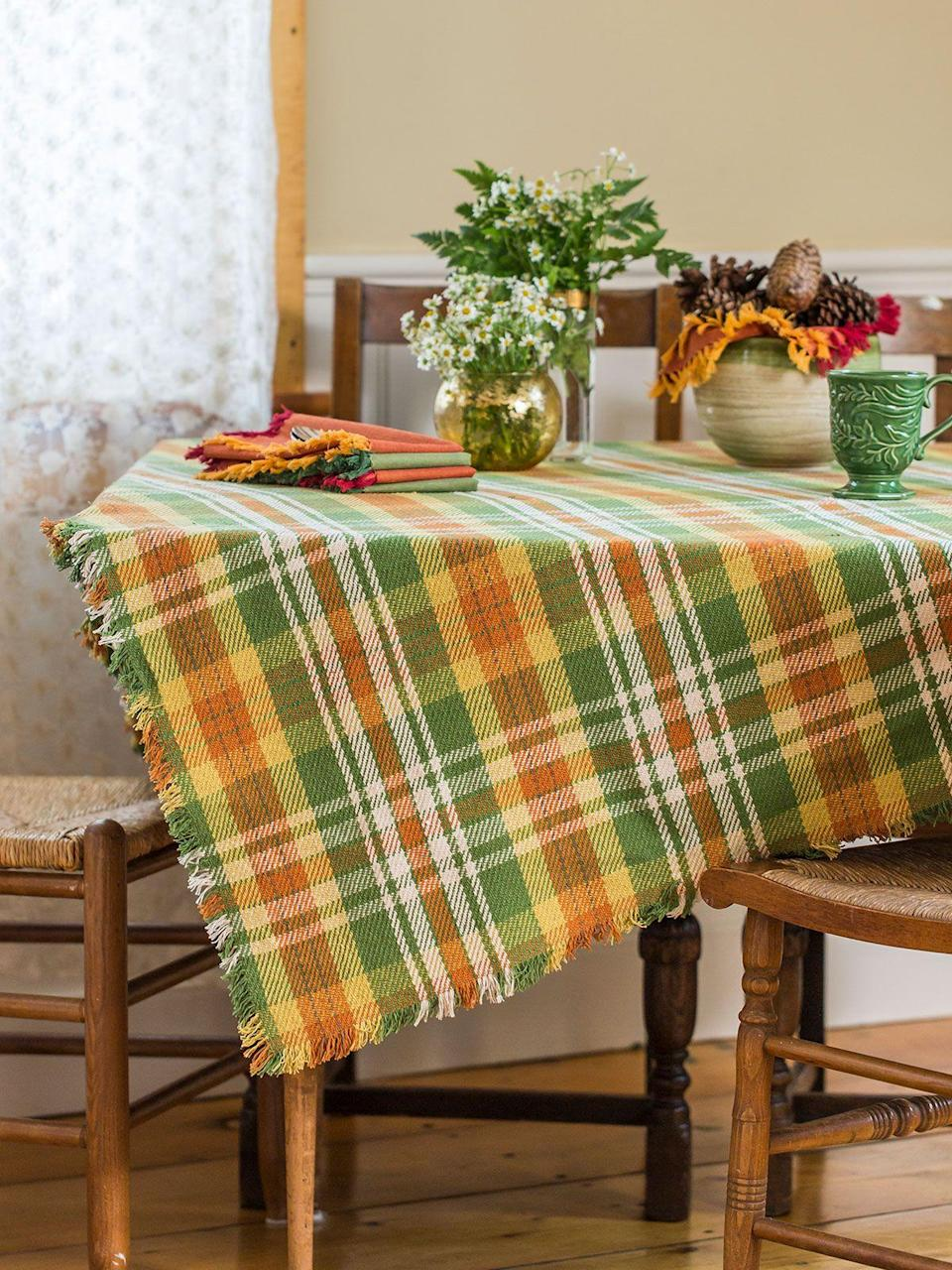 "<p>aprilcornell.com</p><p><strong>$27.20</strong></p><p><a href=""https://www.aprilcornell.com/product/September-Plaid-Tablecloth-TPSPTG-Autumn/linens-kitchen-attic-clearance"" rel=""nofollow noopener"" target=""_blank"" data-ylk=""slk:Shop Now"" class=""link rapid-noclick-resp"">Shop Now</a></p><p>Guests will love cozying up to your warm and welcoming Thanksgiving table outfitted with a seasonal plaid tablecloth.</p>"