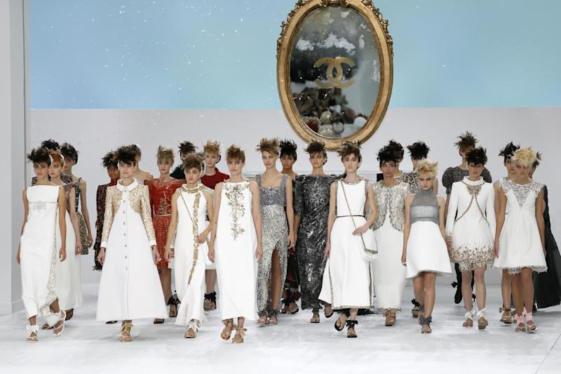 Models present creations for Chanel during the 2014/2015 Haute Couture Fall-Winter collection fashion show on July 8, 2014 at the Grand Palais in Paris (AFP Photo/Patrick Kovarik)