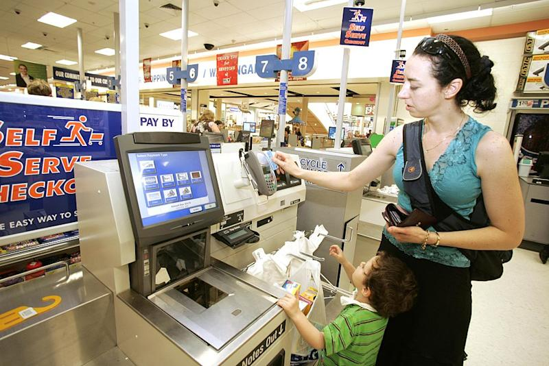 A female customer uses a Big W Self service checkout at Warringah Mall, Sydney, NSW on 8 January 2007.