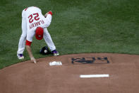 St. Louis Cardinals pitcher Jack Flaherty touches the mound near a Black Lives Matter logo before starting a baseball game against the Pittsburgh Pirates Friday, July 24, 2020, in St. Louis. (AP Photo/Jeff Roberson)