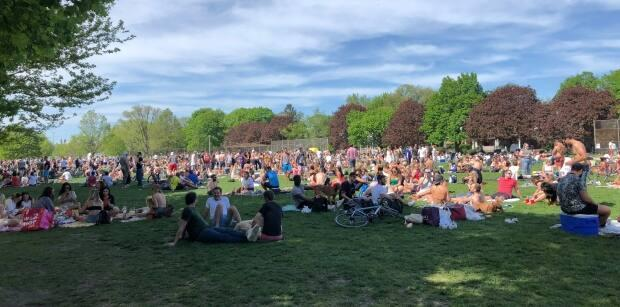 Trinity Bellwoods park in west Toronto was packed with people May 24, 2020, drawing the ire of public officials like Mayor John Tory and Premier Doug Ford. Lees than a year later, a city hall committee has quashed a motion that would making drinking legal in public parks. (Laura Howells/CBC - image credit)