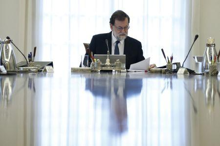 Spain's Prime Minister Mariano Rajoy heads a special cabinet meeting at the Moncloa Palace in Madrid, Spain, October 21, 2017. REUTERS/Juan Carlos Hidalgo/Pool