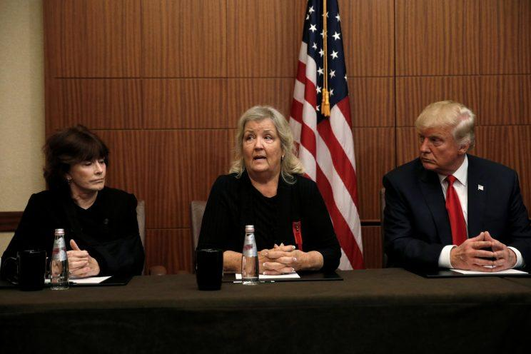 Donald Trump sits with Juanita Broaddrick, center, and Kathleen Willey in a hotel conference room in St. Louis shortly before the second presidential debate at Washington University, October 9, 2016. (Photo: Mike Segar/Reuters)