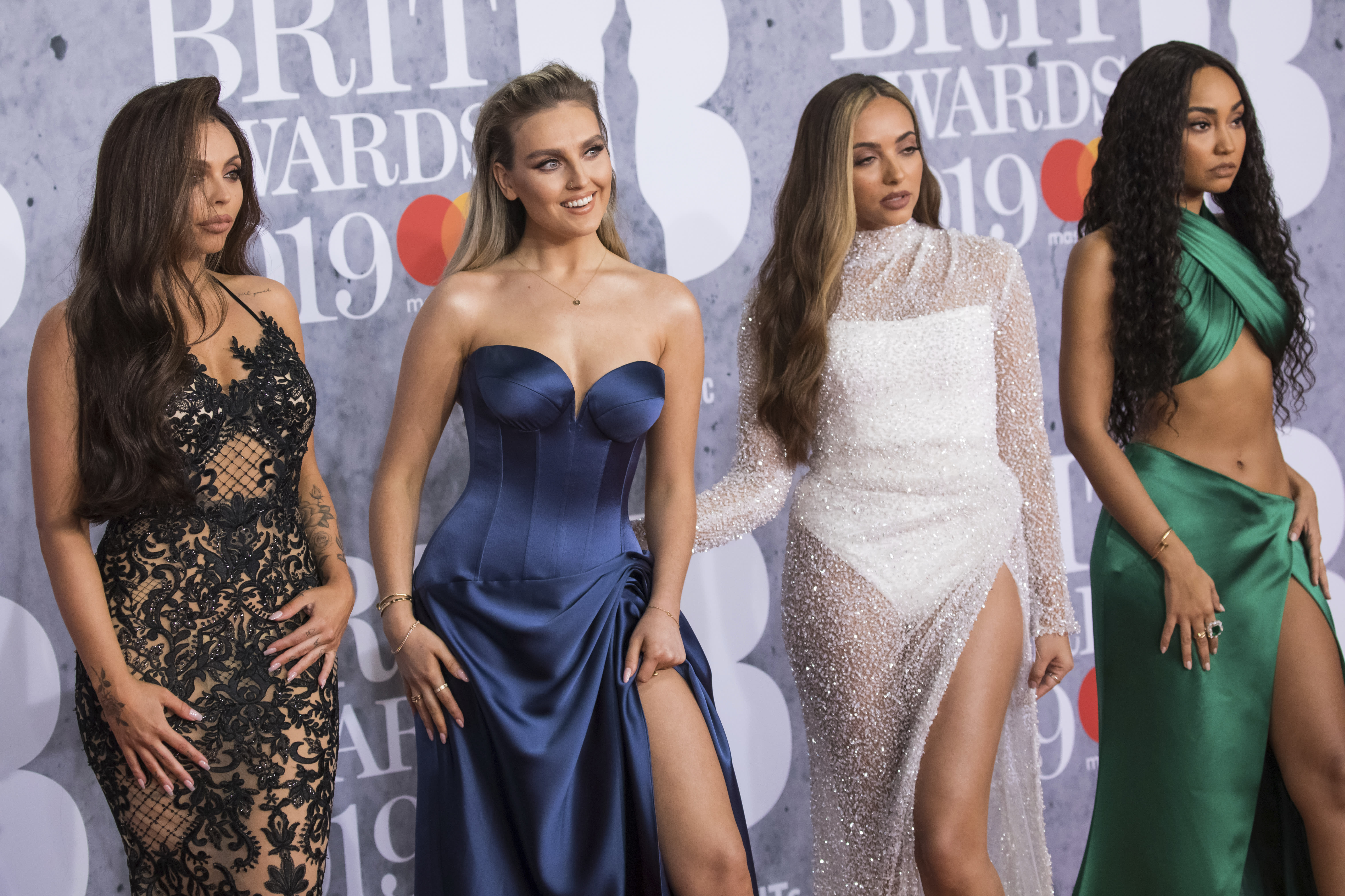 Jesy Nelson, from left, Perrie Edwards, Jade Thirlwall and Leigh-Anne Pinnock from the band Little Mix pose for photographers upon arrival at the Brit Awards in London, Wednesday, Feb. 20, 2019. (Photo by Vianney Le Caer/Invision/AP)