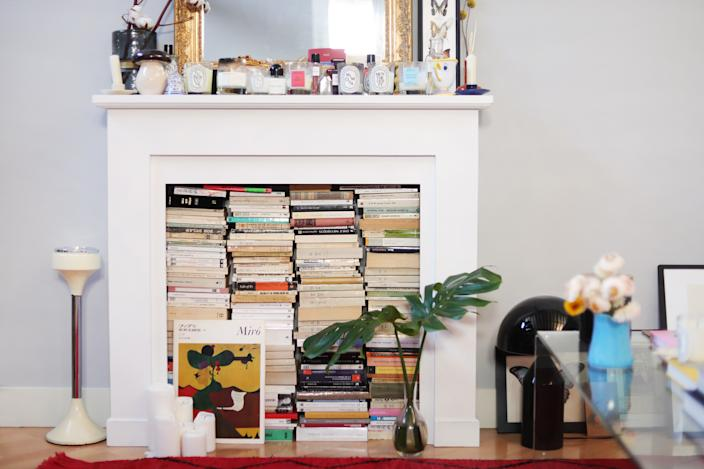 The girls didn't let the nonfunctioning fireplace scare them away. In fact, they emphasized it by filling it with some of their favorite books and accessories picked up during their travels.