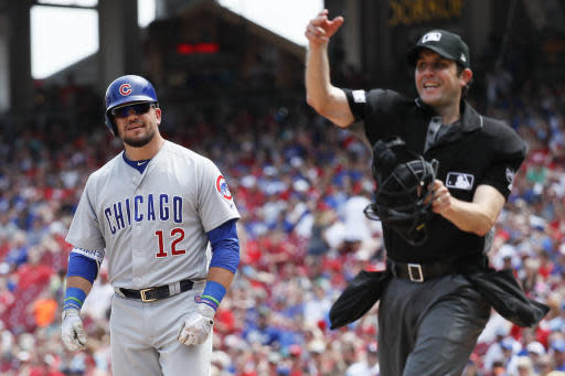 Chicago Cubs' Kyle Schwarber (12) is thrown out of the game by umpire John Tumpane, right, after arguing balls and strikes in the seventh inning of a baseball game, Sunday, May 20, 2018, in Cincinnati. (AP Photo/John Minchillo)