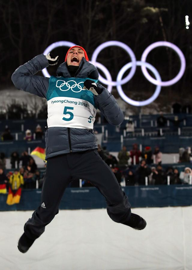 Nordic Combined Events – Pyeongchang 2018 Winter Olympics – Men's Individual 10km Final – Alpensia Cross-Country Skiing Centre - Pyeongchang, South Korea – February 14, 2018 - Gold medalist Eric Frenzel of Germany celebrates during the victory ceremony. REUTERS/Carlos Barria