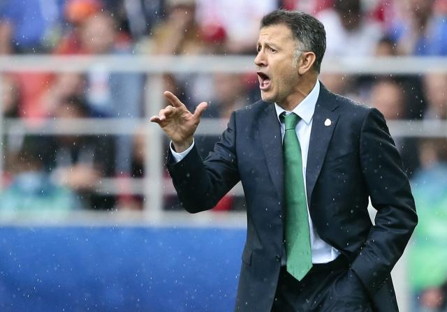 FILE - In this Sunday, July 2, 2017 file photo, Mexico coach Juan Carlos Osorio gives indications to his players during the Confederations Cup, third place soccer match between Portugal and Mexico, at the Moscow Spartak Stadium. (AP Photo/Denis Tyrin, File)