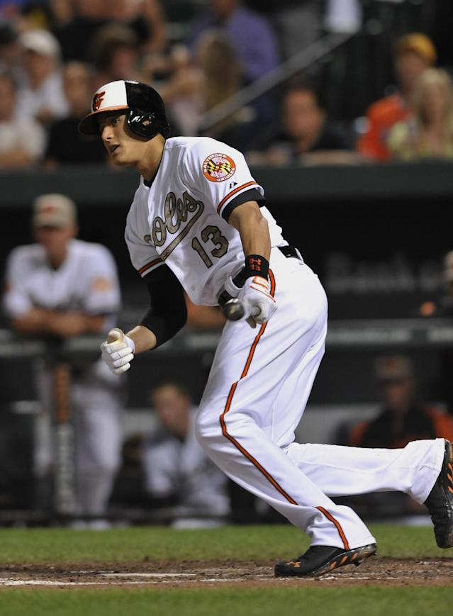 Baltimore Orioles' Manny Machado follows through on a lead off double against the Boston Red Sox in the eighth inning of a baseball game, Friday, June 14, 2013, in Baltimore. The Orioles won 2-0. (AP Photo/Gail Burton)