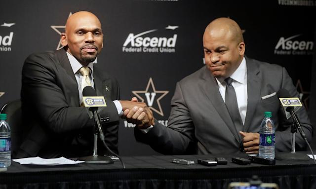 Vanderbilt basketball coach Jerry Stackhouse (L) is introduced by athletic director Malcom Turner during a news conference. Stackhouse was hired to replace Bryce Drew as head coach. (AP)