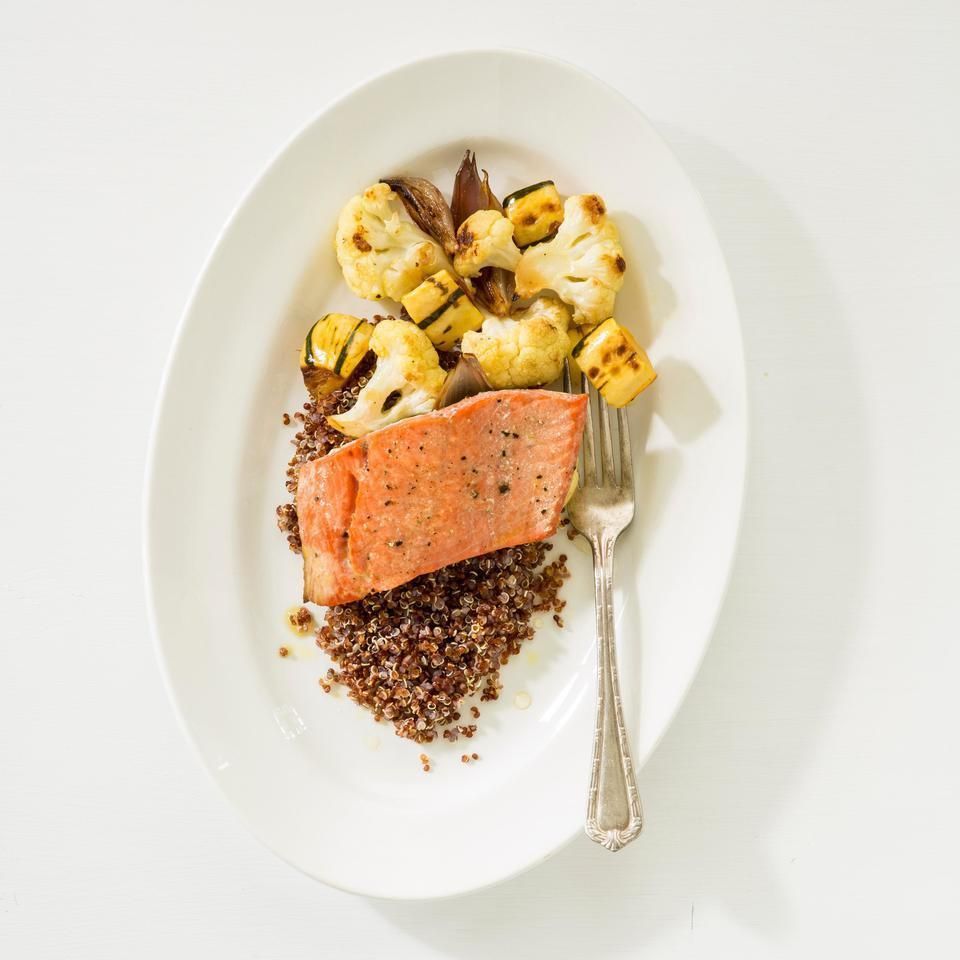 "<p>This healthy salmon recipe has everything you want for a complete meal: omega-3-rich salmon, protein-packed quinoa and lots of vegetables. Drizzled with a maple-lemon dressing, this healthy quinoa dinner also makes a delicious next-day lunch. <a href=""http://www.eatingwell.com/recipe/252713/salmon-with-roasted-vegetables-quinoa/"" rel=""nofollow noopener"" target=""_blank"" data-ylk=""slk:View recipe"" class=""link rapid-noclick-resp""> View recipe </a></p>"