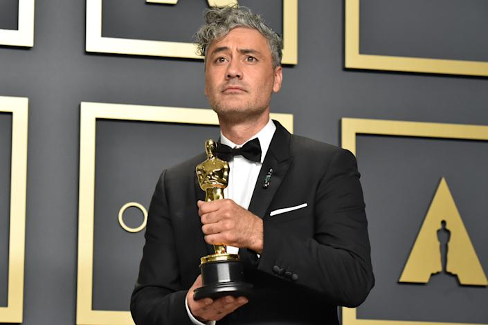 """Taika Waititi, winner of the Adapted Screenplay award for """"Jojo Rabbit,"""" poses in the press room during the 92nd Annual Academy Awards on February 09, 2020. (Credit: Getty)"""