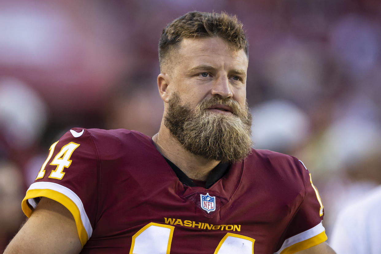 LANDOVER, MD - AUGUST 28: Ryan Fitzpatrick #14 of the Washington Football Team looks on while sitting out the preseason game against the Baltimore Ravens at FedExField on August 28, 2021 in Landover, Maryland. (Photo by Scott Taetsch/Getty Images)