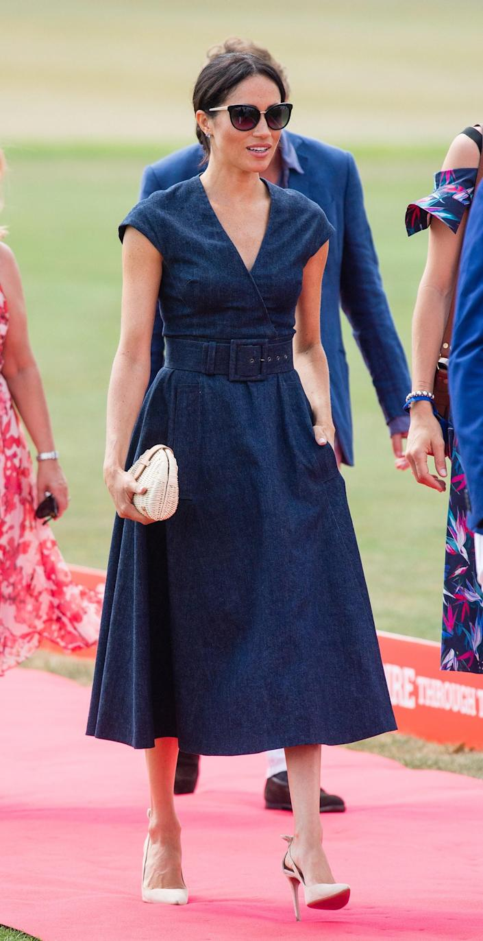 """<div class=""""caption""""> Meghan, Duchess of Sussex attends the Sentebale Polo 2018 held at the Royal County of Berkshire Polo Club on July 26, 2018 in Windsor, England. </div> <cite class=""""credit"""">Samir Hussein</cite>"""