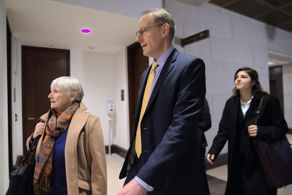 Mark Sandy, a career employee in the White House Office of Management and Budget, arrives at the Capitol to testify in the House Democrats' impeachment inquiry about President Donald Trump's effort to tie military aid to Ukraine to investigations of his political opponents, in Washington, Saturday, Nov. 16, 2019. (AP Photo/J. Scott Applewhite)