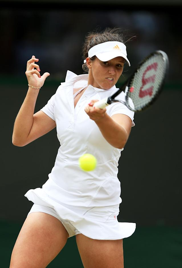 LONDON, ENGLAND - JULY 01: Laura Robson of Great Britain plays a forehand during her Ladies' Singles fourth round match against Kaia Kanepi of Estonia on day seven of the Wimbledon Lawn Tennis Championships at the All England Lawn Tennis and Croquet Club on July 1, 2013 in London, England. (Photo by Clive Brunskill/Getty Images)