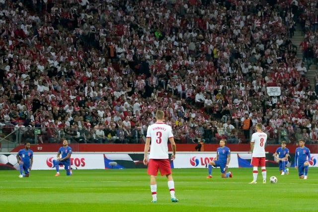 England players take the knee before the World Cup qualifier Poland.