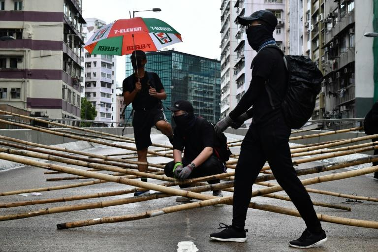 Roads in the financial hub this week have been blockaded with bamboo lattices (AFP Photo/Anthony WALLACE)